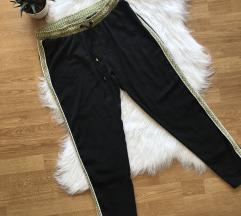 Csinos oldalán csíkos fekete nadrág L
