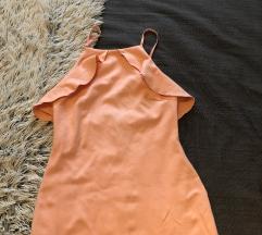 Fodros puderrózsaszín ruha