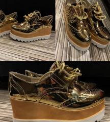 Női platformos arany cipő eladó