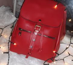 Új, piros háti táska