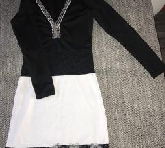 Fekete fehér csipkével díszített ruha