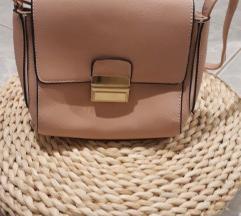 Kis rózsaszin púder táska