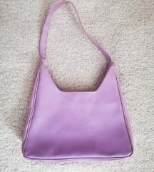 lila kézi táska