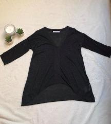 Eladó sötétszürkés csillogó póló