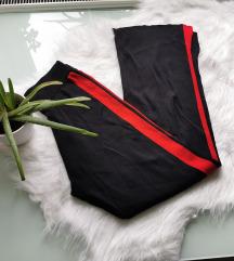 Oldalán piros csíkkal díszített nadrág M Új