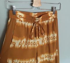 LEÁRAZTAM sárga mintás bő nadrág // H&M