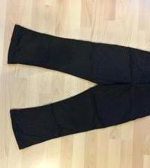 Retró szabású fekete, csillogós nadrág