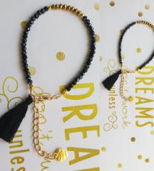 Arany-fekete csiszolt gyöngy karkötő, 17-22 cm