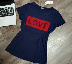 Új, címkés kék love póló