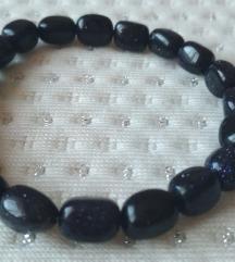 Fekete csillogó köves gumis karkötő