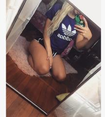 Adidas lila polo