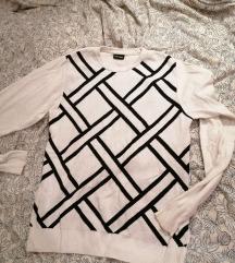 Fekete-fehér geometrikus mintás pulóver