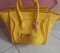 Sárga táska dísszel
